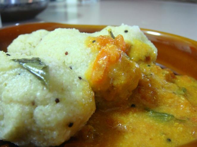 Pidi Kohakattai with Tomato Gravy.