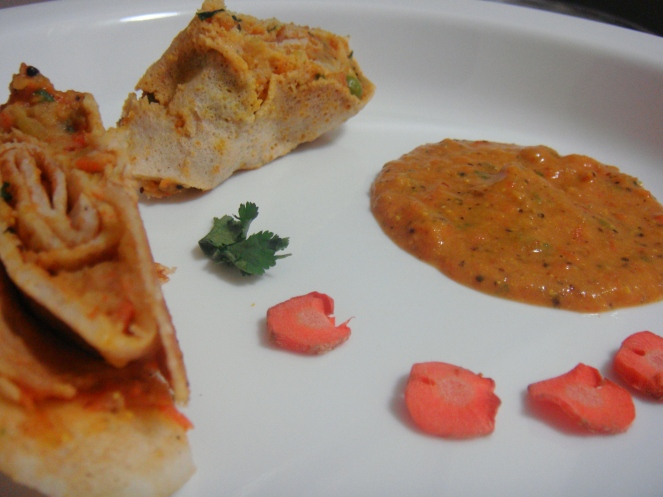 Colourful Stuffed Dosa Rolls served with Tomato Carrot Chutney.