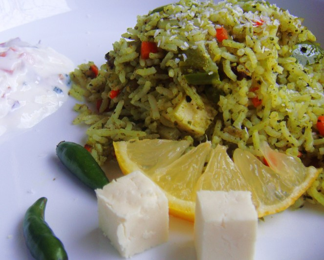Pudina Rice served with Raita and lemon wedge.