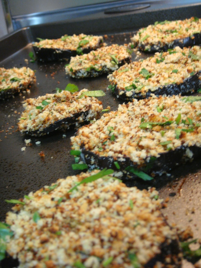 Eggplants dredged with herbed bread crumbs .