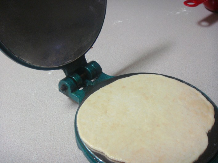 Poori making in the Poori Press.
