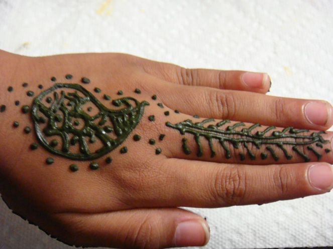 My little one`s hand decorated with Mehndi.