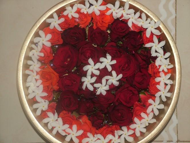 Maduraiamma`s Uruli with flowers.